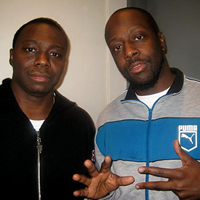 Jimmy Rosemond poses with hip hop artist Wyclef Jean