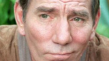 Actor Pete Postlethwaite dies of cancer