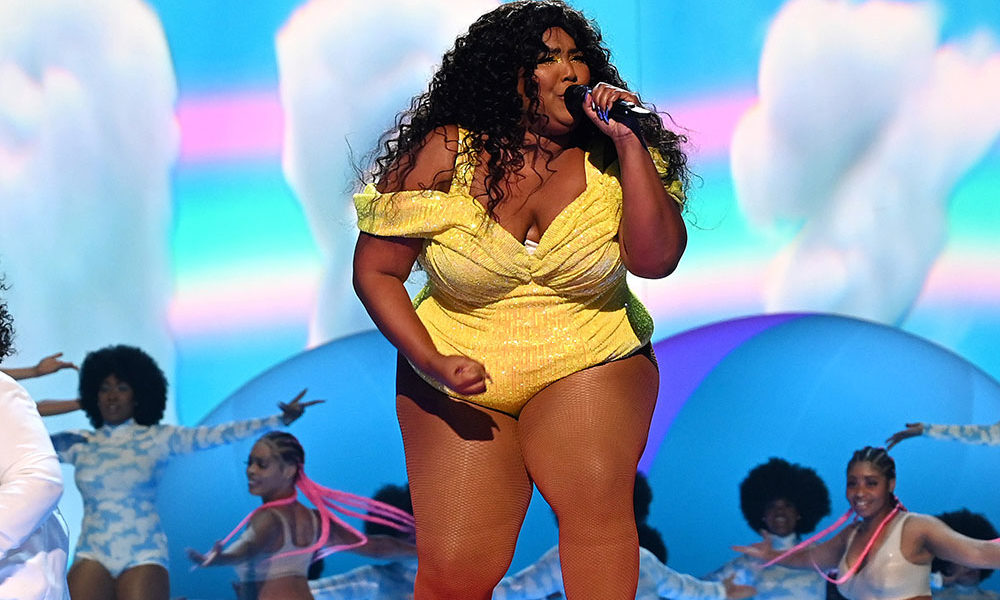 Lizzo preforms on stage