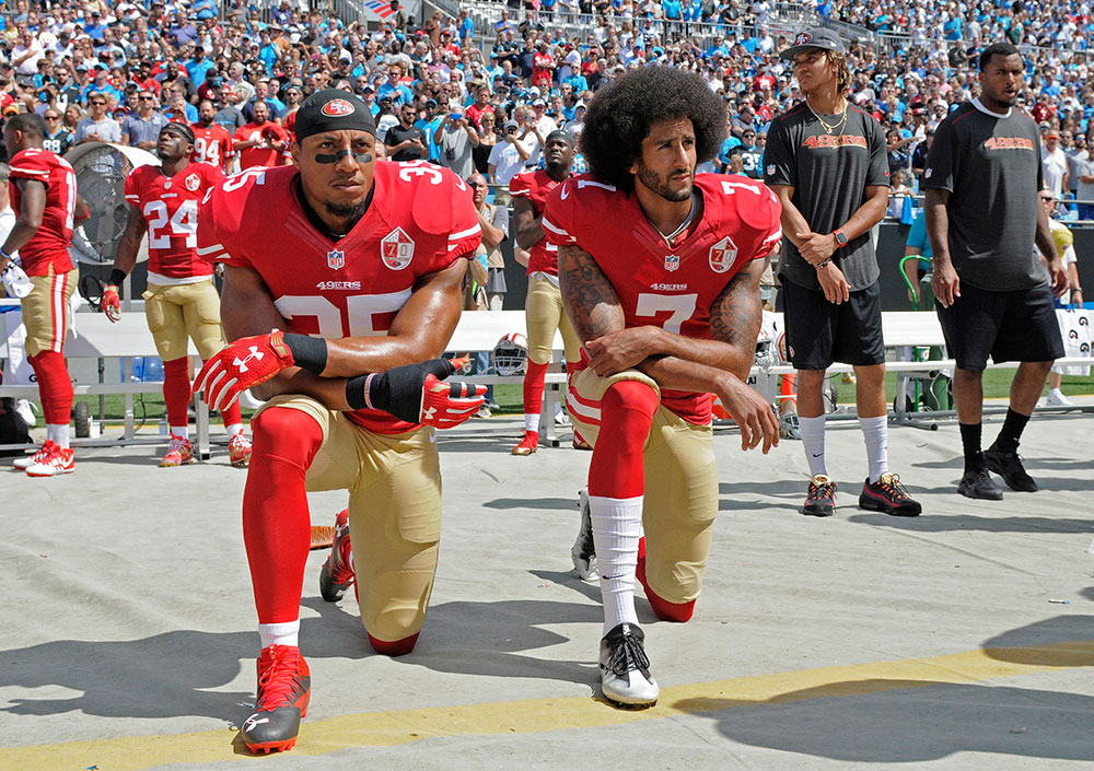 Eric Reid and Colin Kaepernick kneeling